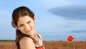 Portrait teen girl with poppy Royalty Free Stock Image
