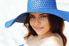 Portrait of a teen girl resting on the beach in hat Stock Photography