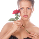 Portrait of teen girl with rose flower and nude makeup. Royalty Free Stock Photos