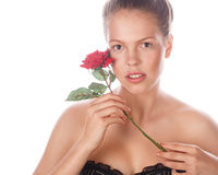 Portrait of teen girl with rose and nude makeup. Isolated. Royalty Free Stock Images