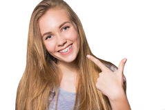Portrait of teen girl showing dental braces. Royalty Free Stock Image