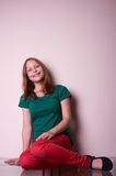 Portrait of a teen girl sitting on table Stock Photography