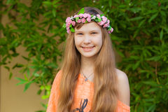Portrait of a teen girl smiling. Portrait of a teen girl with flower band on her head Stock Photography