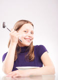 Portrait of a teen girl with spoon Royalty Free Stock Images