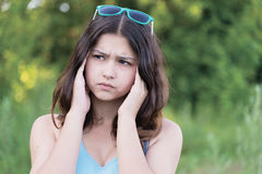 Portrait of teen girl thinking about a problem on nature Stock Photography