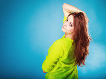 Portrait teen girl in vivid colour sweater on blue Stock Image