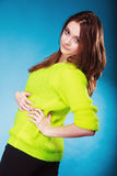 Portrait teen girl in vivid colour sweater on blue Royalty Free Stock Photo