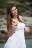 Portrait of a teen girl with white dress at the beach. Playful moment at summer holidays Royalty Free Stock Photography