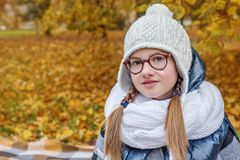 Portrait of a teen girl wonk nerd in glasses royalty free stock photography