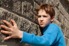 Portrait of  teen about gray wall, outdoor Royalty Free Stock Photos