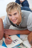 Portrait of a teen guy doing homework Stock Image