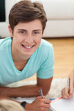 Portrait of a teen guy doing homework Royalty Free Stock Image