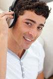 Portrait of teen guy listening to music Royalty Free Stock Photos