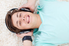 Portrait of teen guy listening to music Stock Photography