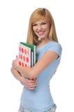 Portrait of teen holding books Stock Photo