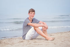 Portrait of teen sitting on sand near sea, Italy Royalty Free Stock Photography