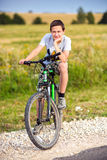 Portrait of a teenage on a bicycle Stock Photography