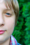 Portrait of teenage boy. On the trees background Royalty Free Stock Photography