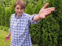 Portrait of teenage boy. On the trees background Royalty Free Stock Images