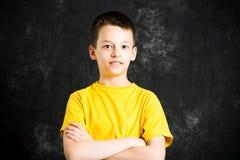 Portrait of teenage boy against dark background. Portrait of teenage a boy against dark background Stock Image