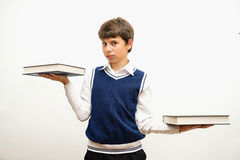 Portrait of teenage boy with books. Stock Image