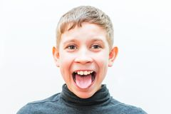 Portrait of a teenage boy with an emotional expression. Portrait of a teenage boy with a silly expression stock photo