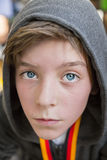 Portrait of a teenage boy with grey hoodie sweatshirts, after sp Stock Image