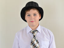 Portrait of a teenage boy in  hat and tie Royalty Free Stock Photography