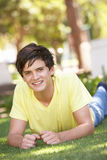 Portrait Of Teenage Boy Laying In Park Royalty Free Stock Photos