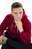 Portrait of teenage boy looking down Royalty Free Stock Photography
