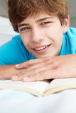 Portrait of teenage boy reading a book Stock Image