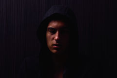 Portrait of teenage boy with serious expression and black hoodie Royalty Free Stock Photos