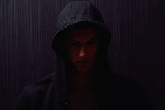 Portrait of teenage boy with serious expression and black hoodie Royalty Free Stock Photography