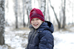 Portrait of the teenage boy in the snow-covered wood. Royalty Free Stock Images