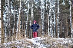 Portrait of the teenage boy in the snow-covered wood. Royalty Free Stock Photography