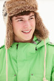 Portrait Of Teenage Boy In Snow Wearing Fur Hat Stock Images
