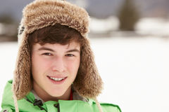 Portrait Of Teenage Boy In Snow Wearing Fur Hat Royalty Free Stock Photo
