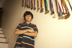Portrait of teenage boy standing with arms crossed Royalty Free Stock Photos