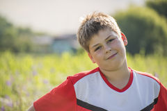 Portrait of a teenage boy in T-shirt Outdoors Royalty Free Stock Image