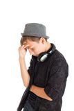 Portrait of a teenage boy wearing a hat with headphones Royalty Free Stock Images