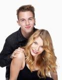 Portrait of a teenage couple Stock Photos