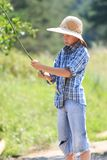 Portrait of teenage fisherman with rod Royalty Free Stock Photos