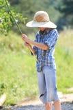 Portrait of teenage fisherman with stick Stock Photo
