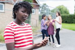 Portrait Of Teenage Girl Being Bullied By Text Message Stock Photo