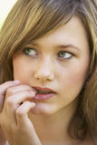 Portrait Of Teenage Girl Biting Nails Stock Photos