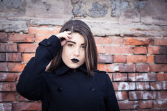Portrait of a teenage girl with black lipstick Stock Images