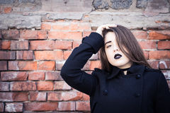 Portrait of a teenage girl with black lipstick royalty free stock photography