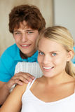 Portrait teenage girl and boy. At home smiling to camera Royalty Free Stock Images