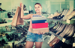 Portrait of teenage girl carrying new shoes boxes Royalty Free Stock Photography