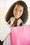 Portrait Of Teenage Girl Carrying Shopping Bags Stock Image